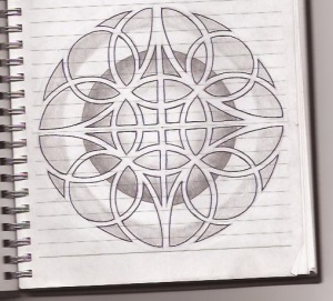 A circle surrounded by a ring of circles. In between them are three more circles made by shading the negative space