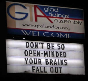 "Real photo of a sign in front of a church that says, ""Don't be so open-minded your brains fall out."""