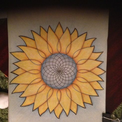 A basic Mandala circle, but where the lines meet at the edge of the circle, they extend outward to make the shapes of sunflower leaves.