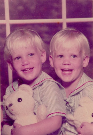 Baby photo of me and my twin holding white teddy bears and wearing stripped sailor outfits. Thanks, mom.