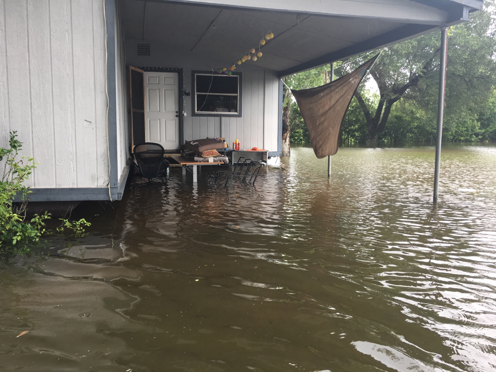 Photo of my trailer house the day after Hurricane Harvey. Water is almost to the floor of the trailer, which is 3-4 feet above the ground